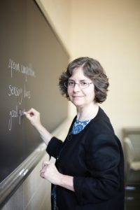 Prof Helen Rodd writing on a chalkboard